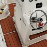 center console of boat with custom installed flooring