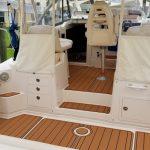 white boat with custom teak deck