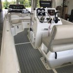 white center console boat with gray decking